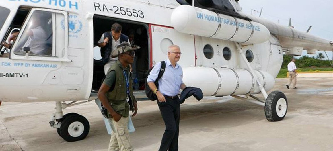 Head of the United Nations Mission for Ebola Emergency Response (UNMEER) Peter Graaff (right) arrives in Guinea-Bissau after new cases were reported near the border with Guinea.