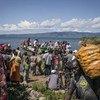 Un barco con refugiados burundeses llega a Baraka, en la República Democrática del Congo. Foto: ACNUR/F. Scoppa