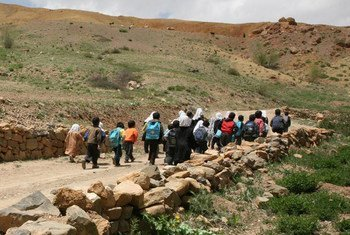 Bamiyan, Afghanistan: children make a long journey to continue their education.