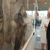 Secretary-General Ban Ki-moon and Laurie Norton Moffatt, Director and CEO of the Norman Rockwell Museum, view works at the exhibit opening.