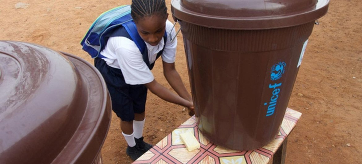 A girl washes her hands at the Slipway primary school in central Monrovia, the capital of Liberia. March 2015