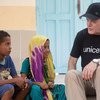 UNICEF UK Ambassador Eddie Izzard with Jawaher and her brother Ziad, at Caritas Educaction Centre, in Obock, Djibouti.