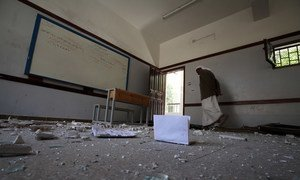 A classroom in Sana'a, heavily damaged during an air strike that hit the building next to the school.