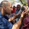 World Health Organization (WHO) official, Dr. Ahmed El Ganainy, checks the eyes of a little girl during a joint humanitarian assessment mission to Marka, Somalia, on 9 July 2014.