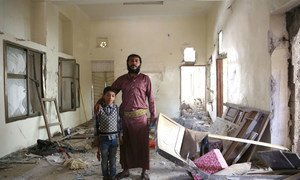 Abdallah and his six-year-old son stand in what used to be the entrance of their home, in Sana'a's Bayt Mayad neighbourhood.