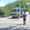 At the Bandeu checkpoint in Nepal, inspectors and a police constable approach a bus to look for potential victims of child trafficking onboard.