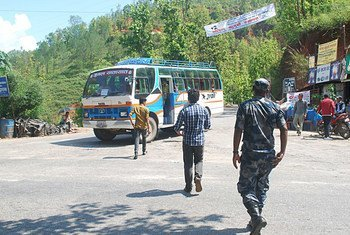 At the Bandeu checkpoint in Nepal, inspectors and a police constable approach a bus to look for potential victims of child trafficking onboard (file photo).