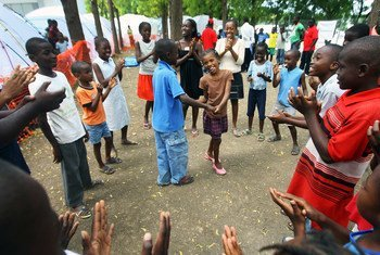 Children at Delmas 33 camp for displaced Haitians play inside a clean, safe area designated by independent organization Save the Children.