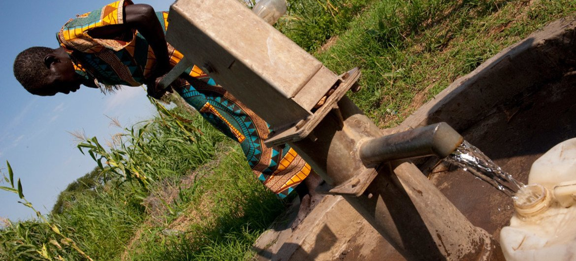 Fetching water at a borehole in the village of Bilinyang, near Juba, South Sudan.
