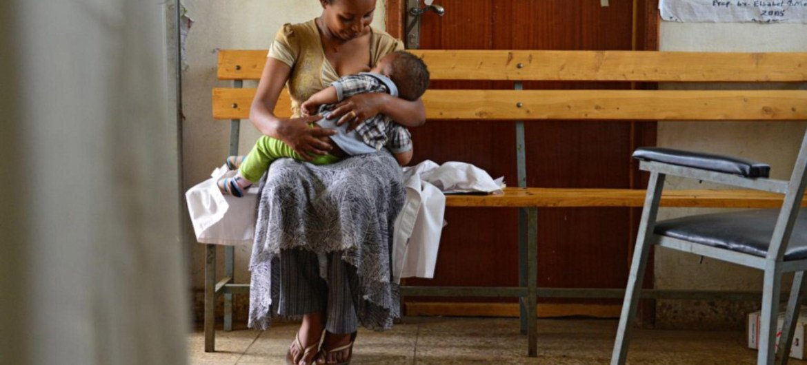In Maderia, Ethiopia, health extension worker Elsebeth Aklilu takes a break from counselling women and their children on best nutrition practices, to breastfeed her own 10-month-old son.