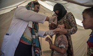 A polio immunization campaign being undertaken in Dahuk, Iraq in September 2014.