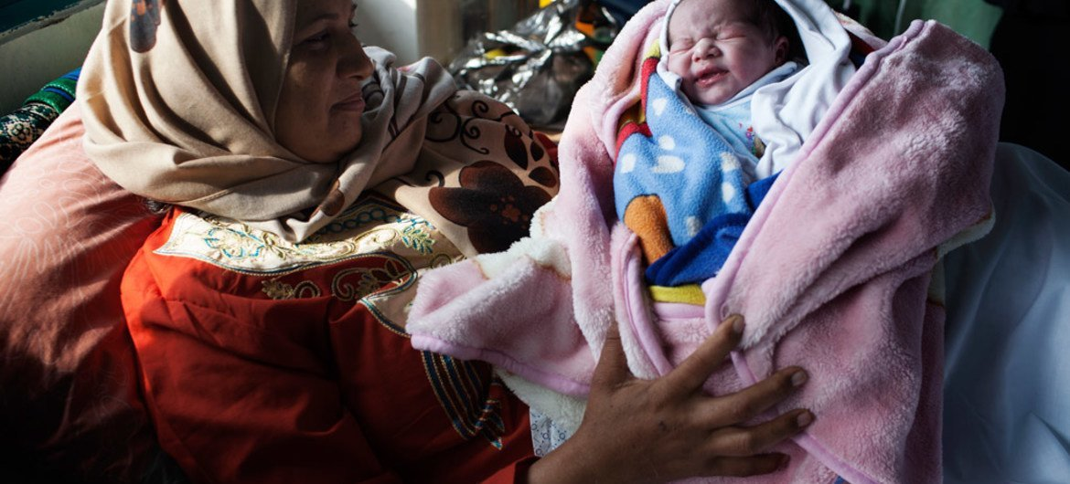 A newly-born baby and mother at the Al Shifa hospital in the Gaza Strip, where the infant mortality rate has risen for the first time in 50 years.