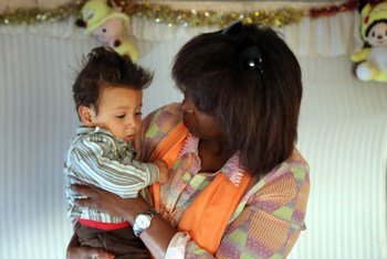 WFP Executive Director Ertharin Cousin with a Syrian refugee child.