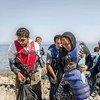 乘船经海路进入希腊的难民。联合国难民署图片/J. Akkash