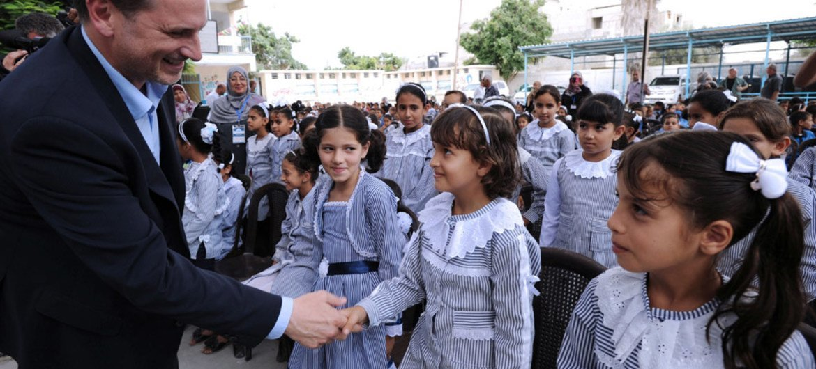 UNRWA Commissioner General Pierre Krähenbühl visiting the Abu Tue'ma school in Khan Younis, Gaza Strip, on 14 September 2014, to celebrate the start of the new school year.