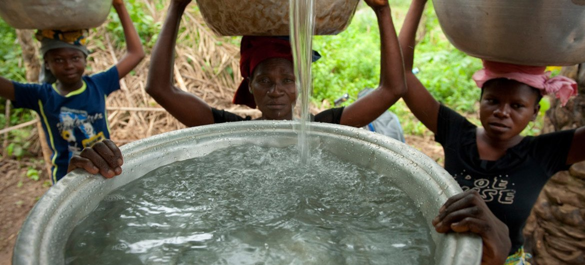 Accessing safe and clean water in Woukpokpoe village, Benin.