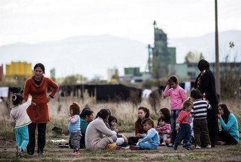 Migrants and asylum-seekers, mostly Syrian Kurds, sit in the yard outside a schoolhouse-turned-reception centre, known as Vrazhdebna, on the outskirts of the Bulgarian capital Sofia.