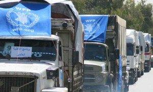 A WFP cross-border convoy moves supplies into northeast Syria.