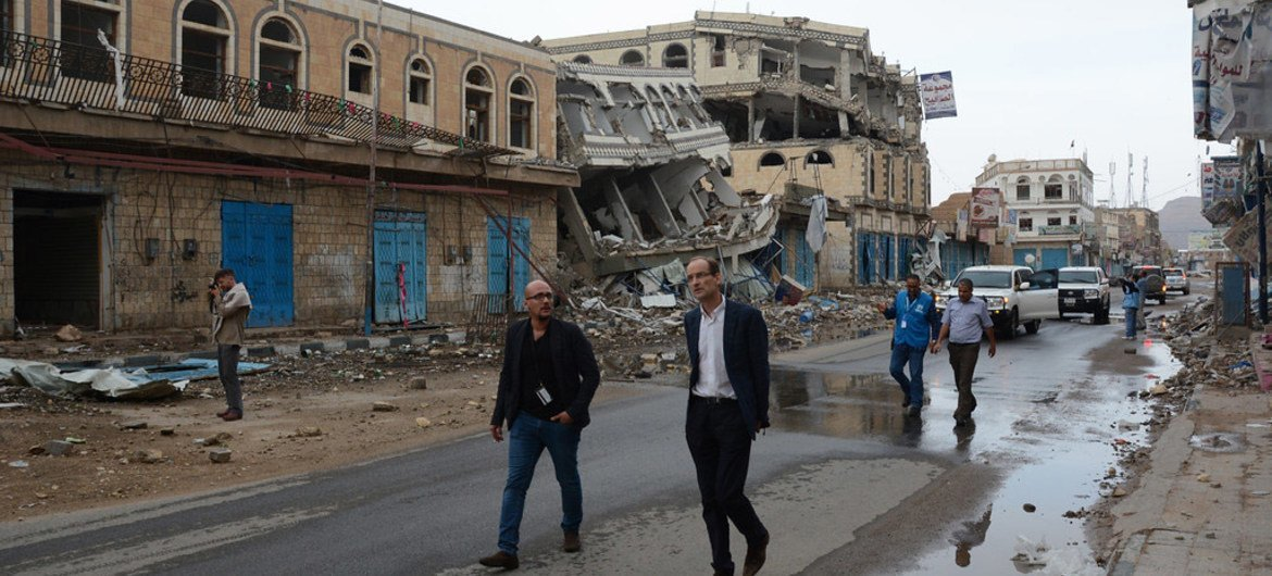 Humanitarian Coordinator for Yemen, Johannes Van Der Klaauw (foreground, right) and members of the inter-agency mission in a street of Sa'ada where shops were destroyed by airstrikes in August 2015.