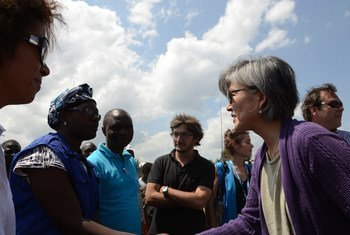 Assistant Secretary-General for Humanitarian Affairs  Kyung-wha Kang (right) on a visit to the Democratic Republic of the Congo (DRC) in 2013.