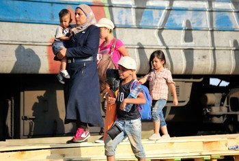 A woman in the Former Yugoslav Republic of Macedonia walks with her grandchildren alongside a train track near Gevgelija, on the border with Greece. They will board the train, hoping to eventually arrive in Germany.