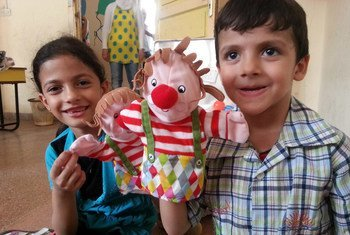 Children play with hand puppets at Ahlam Al-Tofoola kindergarten, in the city of Tartous, Syria.