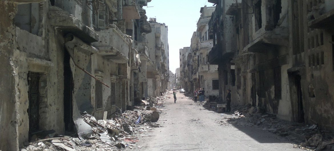 A street lined with rubble and destroyed buildings in the Old City area of Homs, Syria.