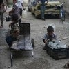 Children fetch water in the town of Douma in the East Ghouta area of Rural Damascus, Syria.