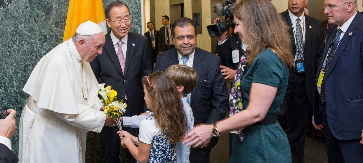 Pope Francis is welcomed by Secretary-General Ban Ki-moon and receives flower bouquets from children of UN staff members at the start of his visit to UN  Headquarters.