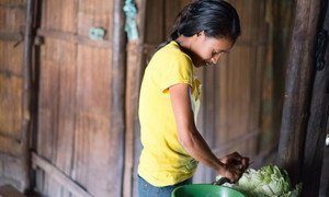 Delfina Soares, 13, in Lauana Groto, Timor-Leste, now attends a UNICEF supported child friendly school. Once she finishes school she has to make her family lunch. UNICEF/PFPG2015-3628/Nazer