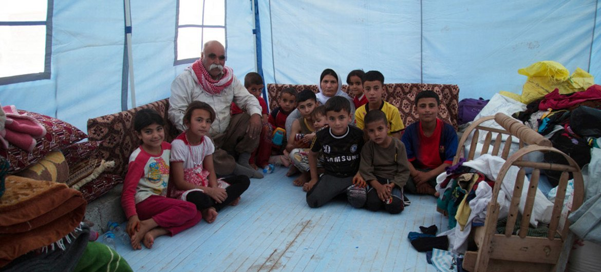 A family in the Sheikhan camp, outside of Dohuk – Kurdistan region of Iraq,