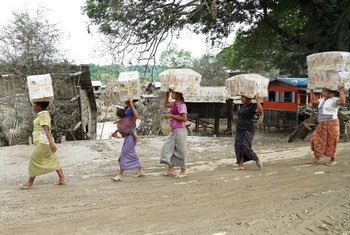 Women carry food to their camp at Kalay township in Sagaing State, northwest Myanmar, which suffered some of the worst devastation from floods in the area.