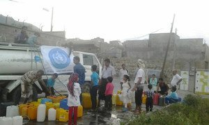 The World Health Organization (WHO) delivering water to residents of Taiz City, Yemen, where water scarcity is a major problem.
