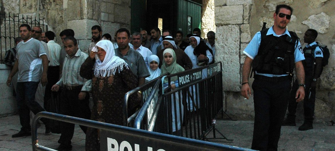 On the Temple Mount in the Old City of Jerusalem, Israel, Muslims leave the  Dome of the Rock after Friday prayers. Police presence is always tight and young males are not allowed or have their ID's seized going in.