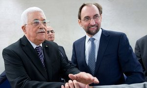 High Commissioner for Human Rights Zeid Ra'ad Al Hussein (right) and Mahmoud Abbas, President of the State of Palestine, at a Special Meeting of the Human Rights Council in Geneva.