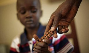A child receiving Tuberculosis medicine in South Sudan under a programme supported by the Global Fund to Fight AIDS, Tuberculosis and Malaria and UNDP.