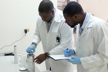 International Centre for Environmental and Nuclear Sciences (ICENS) Director General Charles Grant (left) and Johann Antoine, Head of the Nuclear Analytical Lab, are shown assembling a low enriched uranium (LEU) core for use in Jamaica's Slowpoke research reactor.