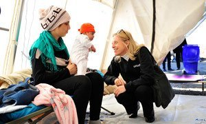 UNICEF Special Coordinator for the Refugee and Migrant Crisis in Europe Marie-Pierre Poirier (right) with refugee children in a UNICEF-supported Child Friendly Space set up at the reception centre in Opatovac, Croatia, on 30 October 2015.