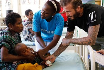 UNICEF Goodwill Ambassador David Beckham meets children receiving treatment for malnutrition at a UNICEF-supported hospital in Papua New Guinea