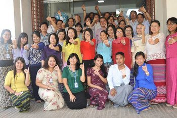 UNDP staff show off their purple pinkies, dipped in the indelible ink used in Myanmar's historic elections, which was provided by UNDP through funding from Japan, Norway, Switzerland and the UK.