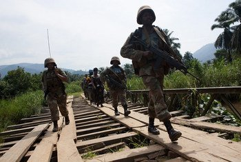 Peacekeepers of the MONUSCO Force Intervention Brigade patrol the town of Pinga as part of a mission to secure the area.