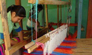 The indigenous Lenca people of southwestern Honduras weaving brightly coloured fabric.