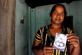 Vijitha Pavanendran holds a photo of her husband who was killed by unknown attackers during Sri Lanka's civil war.