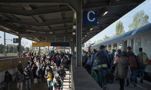 Migrants and refugees from several countries arrive by special train in Berlin, Germany.