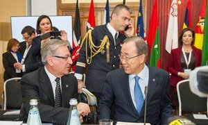 Secretary-General Ban Ki-moon (right) confers with Karmenu Vella, European Commissioner for the Environment, Maritime Affairs and Fisheries at a special session on climate change as the Commonwealth Heads of State and Government meet in Malta.