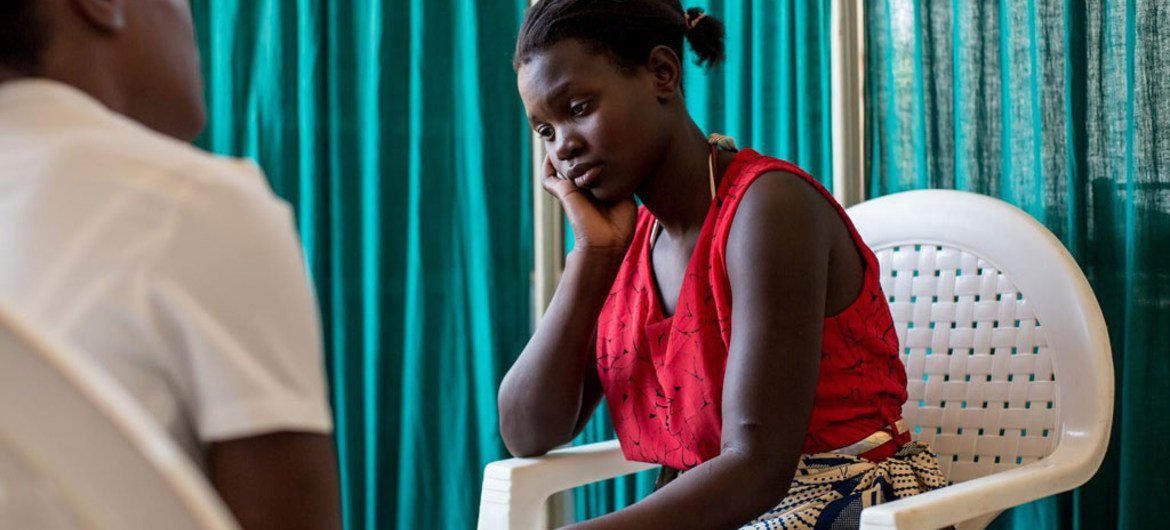 Malawi teen, Martha, was born with HIV. Now a mother herself, she has defied the odds and her son, Rahim Idriss, is part of Malawis AIDS-free generation. In this picture, she awaits the results of Rahmins HIV test. After two months of waiting, she finds out the Rahmin, now 8-months old, is HIV negative.
