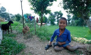 Ten year old Babu Kaji Tamang, who gets around by crawling on all fours, at his home  in Sindhupalchwok, Nepal, one of the most earthquake-affected districts.