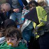 Children and their parents arrive on the Greek island of Lesbos, in the North Aegean region.