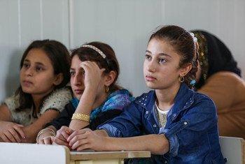 Children attend school at Harsham Camp for internally displaced people in Erbil, Iraq.