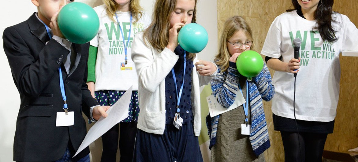 At the opening event for 'Young and Future Generations Day' at the UN climate change conference (COP21), young climate advocates blow up balloons, representing the earth. 3 December 2015.